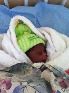 Moses is a 2 week old baby who was abandoned on the banks of the river running through Murambinda township. Local people brought him to Murambinda Mission Hospital. Here the hospital nourished him, kept him warm, provided him with clothes, and treated the eye infection he was suffering from. The staff took it in turns to hold Moses and show him the love and care he deserves, with one of the nurses volunteering to be Moses' godfather. Without Murambinda Mission Hospital it is likely that Moses would have been left by the river to die. Following his recovery the hospital took care of Moses until suitable care was arranged for him.